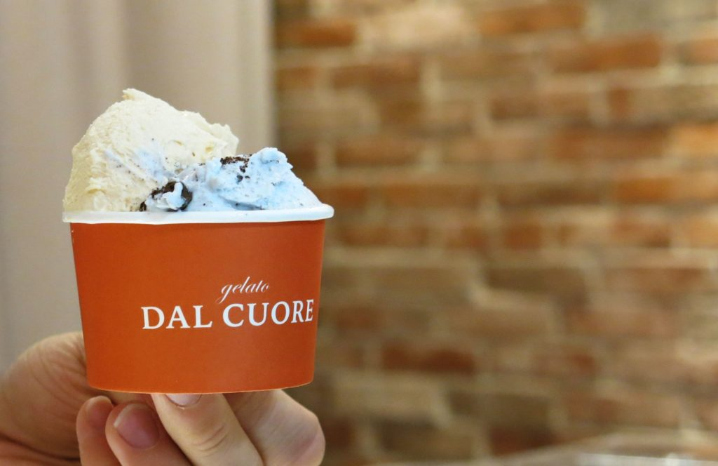 Salted caramel gelato paired with pale blue Milk and cookies gelato from Gelato Dal Cuore.